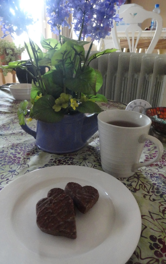 OK - this is my new favorite cookie, sugar wafer hearts, filled with cocoa-rum truffle cream and dipped in chocolate - oh wow!