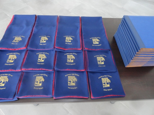 The handmade scarfs and diplomas were set out,