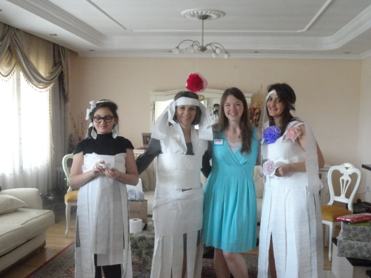We played that all American, toilet paper bride game. Yep, those are Kosovar ladies we dressed up!