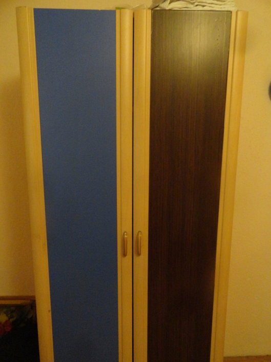 I covered the blue wardrobe with contact paper to make it look like wood,