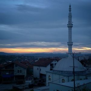 Sunset over Pristina. This mosque is very near our home and school. (Thanks, Angela for the picture)