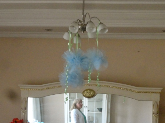 Puffy balls of tulle hanging from the lights are fun.
